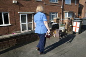 Community nurse on her rounds. Bristol - Paul Box - ,2010,2010s,care,cities,city,communities,Community,community nurse,district,EARNINGS,employee,employees,Employment,EQUALITY,FEMALE,hea,health,HEALTH SERVICES,Health Visitor,Health Visitors,Health Work