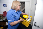 Community nurse on her rounds. Bristol - Paul Box - 2010,2010s,care,caring,cities,city,communities,Community,community nurse,district,EARNINGS,employee,employees,Employment,EQUALITY,FEMALE,for,hea,health,HEALTH SERVICES,Health Visitor,Health Visitors,H