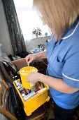 Community nurse on her rounds. Bristol - Paul Box - 2010,2010s,care,cities,city,communities,Community,community nurse,district,EARNINGS,employee,employees,Employment,EQUALITY,FEMALE,hea,health,HEALTH SERVICES,Health Visitor,Health Visitors,Health Worke
