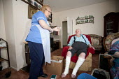 Community nurse on her rounds. Bristol - Paul Box - 2010,2010s,adult,adults,age,ageing population,bandage,care,caring,cities,city,communities,Community,community nurse,district,dressing,EARNINGS,elderly,employee,employees,Employment,EQUALITY,FEMALE,for
