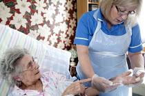 Community nurse on her rounds. Bristol - Paul Box - 09-03-2010