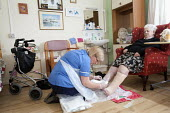 Community nurse on her rounds. Bristol - Paul Box - 2010,2010s,adult,adults,age,ageing population,bandage,bandaging,care,caring,check,checking,checks,cities,city,clean,cleaning,cleansing,communities,Community,community nurse,district,dressing,EARNINGS,