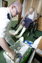Community nurse with a patient at the Brooklea Health Centre clinic. Bristol. - Paul Box - 09-03-2010