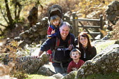 A family hiking up the Cader Idris or Cadair Idris mountain, situated in the Snowdonia National Park, North Wales. - Paul Box - 28-10-2010