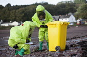 West Wales Fire and rescue service carry out a mock Chemical spill at Gelliswick Bay, Pembrokeshire - Paul Box - 2010s,2011,adult,adults,beach,beaches,breathing apparatus,chemical,chemicals,coast,coastal,coasts,degradation,DIA,Emergency Services,eni,environment,Environmental,environmental degradation,Environment