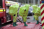 West Wales Fire and rescue service carry out a mock Chemical spill at Gelliswick Bay, Pembrokeshire - Paul Box - 2010s,2011,adult,adults,contamination,decontamination,DIA,Emergency Services,exercise,exercises,Fire AND rescue,fire brigade,Fire Engine,firefighter,firefighters,fireman,firemen,Hazmat,Hazmat suit,inc