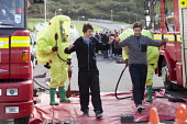West Wales Fire and rescue service carry out a mock Chemical spill at Gelliswick Bay, Pembrokeshire - Paul Box - ,2010s,2011,adult,adults,contamination,decontamination,DIA,Emergency Services,exercise,exercises,Fire AND rescue,fire brigade,Fire Engine,firefighter,firefighters,fireman,firemen,Hazmat,Hazmat suit,in