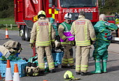 West Wales Fire and rescue service carry out a mock Chemical spill at Gelliswick Bay, Pembrokeshire - Paul Box - 2010s,2011,adult,adults,chemical,CHEMICALS,DIA,Emergency Services,equipment,exercise,exercises,Fire AND rescue,fire brigade,firefighter,firefighters,fireman,firemen,GTB,hasmat,Hazmat,Hazmat suit,incid