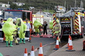 West Wales Fire and rescue service carry out a mock Chemical spill at Gelliswick Bay, Pembrokeshire - Paul Box - 2010s,2011,adult,adults,chemical,CHEMICALS,contamination,decontamination,DIA,Emergency Services,exercise,exercises,Fire AND rescue,fire brigade,firefighter,firefighters,fireman,firemen,GTB,hasmat,Hazm
