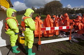 West Wales Fire and rescue service carry out a mock Chemical spill at Gelliswick Bay, Pembrokeshire - Paul Box - ,2010s,2011,adult,adults,chemical,CHEMICALS,contamination,decontamination,DIA,Emergency Services,exercise,exercises,Fire AND rescue,fire brigade,firefighter,firefighters,fireman,firemen,GTB,hasmat,haz