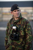 The chief photographer of the army at The1st Battalion The Black Watch (Royal Highland Regiment) (1 BW) arrive back to their base on December 11, 2004 at the Battlesbury Barracks, Warminster, England.... - Paul Box - 2000s,2004,army,blackwatch,camera,cameras,camouflage,closed,closing,closure,closures,conflict,cuts,Iraq,photographer,photographers,returning,scottish,soldier,soldiers,troops,UCW conflicts & war,unifor