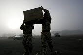 Soldiers unload luggage .The1st Battalion The Black Watch (Royal Highland Regiment) (1 BW) arrive back to their base on December 11, 2004 at the Battlesbury Barracks, Warminster, England. The troops h... - Paul Box - 11-12-2004