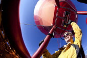 Hot air balloon pilot of Rotork balloon at the Chateaux dOex Balloon Festival, Switzerland. - Paul Box - 26-01-2011