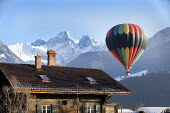 Hot air balloon at the Chateaux dOex Balloon Festival, Switzerland. - Paul Box - 26-01-2011