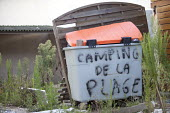 Camping de la Plage, a campsite damaged by Xynthia a violent European storm in 2010 which killed 51 people in France. The campsite remains deserted, in Aytr - Paul Box - 2010s,2011,abandon,atmospheric,bin,bins,camp,Camping,camps,campsite,campsites,CLIMATE,conditions,cyclonic,damage,damaged,derelict,DERELICTION,deserted,destroyed,destruction,disused,EBF,Economic,Econom