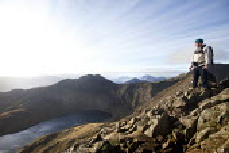 A man climbing Grib Goch ridge in Snowdonia National Park, North Wales. Lyn Llydaw below. - Paul Box - 28-10-2011