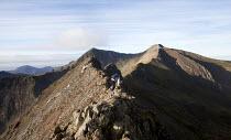 A man climbing Grib Goch ridge in Snowdonia National Park, North Wales. - Paul Box - 28-10-2011