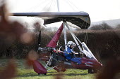 A microlight aircraft flight in Oxfordshire. - Paul Box - 2010s,2012,aeroplane,aeroplanes,air transport,aircraft,aircrafts,airplane,airplanes,aviation,country,countryside,flight,flights,flown,fly,flying,helmet,helmets,hobbies,hobby,hobbyist,land,landing,Leis
