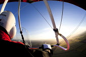 A microlight aircraft flight in Oxfordshire. - Paul Box - 2010s,2012,aeroplane,aeroplanes,air transport,aircraft,aircrafts,airplane,airplanes,aviation,country,countryside,field,fields,flight,flights,flown,fly,flying,helmet,helmets,hobbies,hobby,hobbyist,Leis