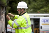 BT Openreach, installing a new telephone line to a house, Pembrokeshire, Wales. - Paul Box - 13-06-2011