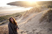 A woman laughing, Freshwater West, Pembrokeshire, Wales. - Paul Box - 13-06-2011