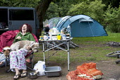 Woman playing with her dogs at Pool Farm Campsite, Porlock, Somerset. - Paul Box - 09-08-2011