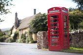 A red telephone box in Bossington, Somerset. - Paul Box - 2010s,2011,booth,booths,box,boxes,calls,communicating,communication,cottage,cottages,country,countryside,EBF,Economic,Economy,kiosk,outdoors,outside,phone,phones,public,rural,SCT,technology,telephone,