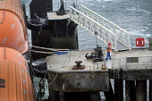 Dockworker tying up a passenger ferry docking at Plymouth. - Paul Box - 26-09-2011