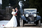 A winter wedding in Derby. - Paul Box - 2010,2010s,AUTO,AUTOMOBILE,AUTOMOBILES,AUTOMOTIVE,bonquets,bouquet,Boutonnieres,bow,bridal,bride,brides,car,cars,classic,dress,dresses,FEMALE,Getting Married,groom,grooms,Groomsmen,hairstyle,highway,h