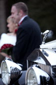 A winter wedding in Derby. - Paul Box - 2010,2010s,AUTO,AUTOMOBILE,AUTOMOBILES,AUTOMOTIVE,bonquets,bouquet,Boutonnieres,bride,brides,car,cars,classic,ecstacy,Ecstasy,FEMALE,figure,figures,Getting Married,groom,grooms,Groomsmen,hood,husband,