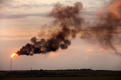 A flare burning gas from the Dragon LNG Pembroke. The gas is burned when there is a problem at the site and they need to release the gas. - Paul Box - (CNG),(LPG),2010s,2011,Air Pollution,Air Quality,burn,burning,BURNS,capitalism,capitalist,chimney,chimneys,Compressed,country,countryside,degradation,domestic,EBF,Economic,Economy,energies,energy,eni,