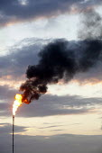 A flare burning gas from the Dragon LNG Pembroke. The gas is burned when there is a problem at the site and they need to release the gas. - Paul Box - (CNG),(LPG),2010s,2011,Air Pollution,Air Quality,burn,burning,BURNS,capitalism,capitalist,chimney,chimneys,Compressed,degradation,domestic,EBF,Economic,Economy,energies,energy,eni,environment,Environm