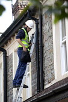 A BT Openreach engineer installing fibre optic broadband. - Paul Box - 24-06-2011