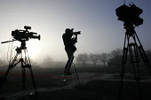 Tv crews and a photographer await the arrival of the 1st Battalion The Black Watch (Royal Highland Regiment) (1 BW) at base on December 11, 2004 at the Battlesbury Barracks, Warminster, England. The t... - Paul Box - 2000s,2004,army,ARRIVAL,arrivals,arrive,arrived,arrives,arriving,blackwatch,broadcast,broadcasting,camera,cameras,closed,closing,closure,closures,conflict,dawn,early morning,freelance,freelances,home,