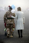 Soldiers sister puts arm around her brother. 1st Battalion The Black Watch (Royal Highland Regiment) (1 BW) arrive back at base on December 11, 2004 at the Battlesbury Barracks, Warminster, England. T... - Paul Box - 11-12-2004