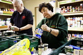 Volunteers in the warehouse sorting donated food at the Cardiff Foodbank, part of the Trussell Trust and the National Foodbank Network, which is set up to help and support those suffering hardship. - Paul Box - 10-05-2012