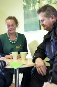 Volunteers talk over a cup of tea with Foodbank users at the City Foodbank Centre. Cardiff Foodbank is part of the Trussell Trust and the National Foodbank Network. It is set up to help and support th... - Paul Box - &,2010s,2012,agencies,agency,aid,assistance,belief,charitable,charities,charity,christian,christianity,christians,cities,city,communicating,communication,conversation,conversations,conviction,dialogue