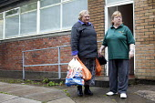 A volunteer gives some bags of food to a Foodbank user at the Ely Foodbank Centre. Cardiff Foodbank is part of the Trussell Trust and the National Foodbank Network. It is set up to help and support th... - Paul Box - &,2010s,2012,age,ageing population,agencies,agency,aid,assistance,BAG,bags,belief,charitable,charities,charity,christian,christianity,christians,cities,city,conviction,distribution,donations,elderly,E