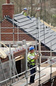 Builders erecting new housing near Taunton, Somerset. - Paul Box - 2010s,2012,build,builder,builders,building,building site,Building Worker,BUILDINGS,construction,Construction Industry,Construction Workers,Crest Nicholson,development,EBF,Economic,Economy,employee,emp