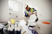 A painter and decorator working on new housing near Taunton, Somerset. - Paul Box - 22-03-2012