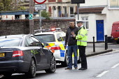 Police interview one of the drivers at the scene of a car crash on the slip road of the M32, Bristol. - Paul Box - 2010s,2012,accident,accidental,accidents,adult,adults,asian,asians,AUTO,AUTOMOBILE,AUTOMOBILES,AUTOMOTIVE,BAME,BAMEs,Black,BME,bmes,car,cars,cities,city,CLJ,collision,crash,crashed,damage,damaged,dia,