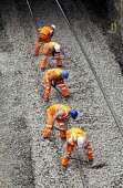 A gang of agency workers shovelling track ballast. Portishead to Bristol freight line being upgraded. - Paul Box - 20-05-2012