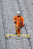 Workers checking the track with a Geismar track gauge. Portishead to Bristol freight line being upgraded. - Paul Box - 20-05-2012