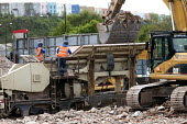 A building is demolished and all the concrete and hardcore is sorted, crushed and recycled using a Nordberg LT105 38 ton mobile tracked crushing plant. Templemeads Railway Station, Bristol. - Paul Box - 14-05-2012