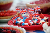 Celebrations of the Queens Diamond Jubilee, Llanmartin, Wales. - Paul Box - 2010s,2012,Cake,cakes,CELEBRATE,celebrating,celebration,celebrations,confectionery,eat,eating,flag,flags,food,FOODS,fruit,FRUITS,holiday,holidays,Leisure,LFL,LIFE,nationalism,PEOPLE,RECREATION,RECREAT