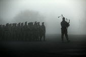 A piper leads 1st Battalion The Black Watch (Royal Highland Regiment) (1 BW) back to their base on December 11, 2004 at the Battlesbury Barracks, Warminster, England. The troops had served in the Iraq... - Paul Box - 11-12-2004