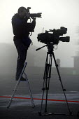 Tv crews and a photographer await the arrival of the 1st Battalion The Black Watch (Royal Highland Regiment) (1 BW) at base on December 11, 2004 at the Battlesbury Barracks, Warminster, England. The t... - Paul Box - 11-12-2004