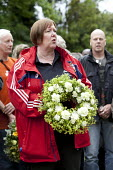 Cath Speight Unite places a Wreath are placed on the grave of Wreaths are placed on the grave of James Hammett one of the Tolpuddle Martyrs at The Tolpuddle Martyrs festival, Tolpuddle - Paul Box - 15-07-2012