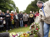 Paul Kenny TUC pre places a Wreath are placed on the grave of James Hammett one of the Tolpuddle Martyrs at The Tolpuddle Martyrs festival, Tolpuddle - Paul Box - 2010s,2012,cemeteries,cemetery,ceremonial,ceremonies,ceremony,DEATH,DEATHS,died,festival,FESTIVALS,floral,flower,flowering,flowers,gmb,grave,graves,gravestone,gravestones,graveyard,graveyards,headston