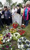 Wreaths are placed on the grave of James Hammett one of the Tolpuddle Martyrs at The Tolpuddle Martyrs festival, Tolpuddle - Paul Box - 2010s,2012,cemeteries,cemetery,ceremonial,ceremonies,ceremony,DEATH,DEATHS,died,festival,FESTIVALS,floral,flower,flowering,flowers,grave,graves,gravestone,gravestones,graveyard,graveyards,grief,grieve